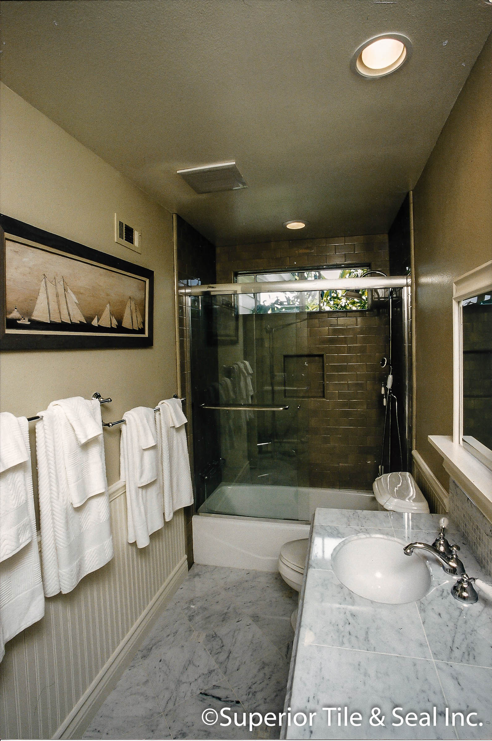 Limnestone Counter Top And Floor With Ceramic Tile Tub Shower 1